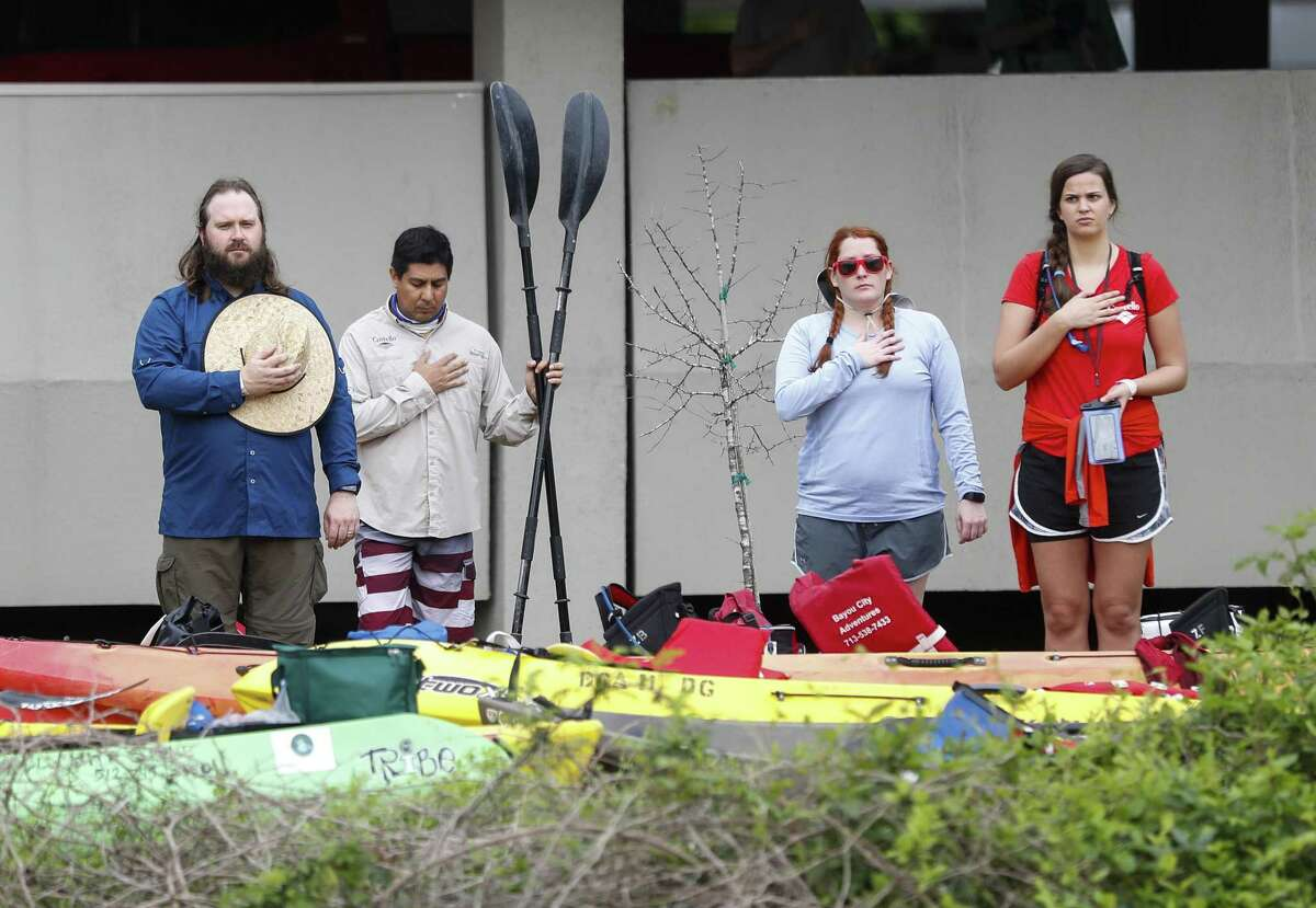 Participants in the 47th Annual Buffalo Bayou Partnership Regatta, stop what they were doing as the National Anthem played, before the start of the race, Saturday, March 9, 2019, in Houston. The regatta is Texas' largest canoe and kayak race, and spans 15 miles with the finish line at Allen's Landing downtown.