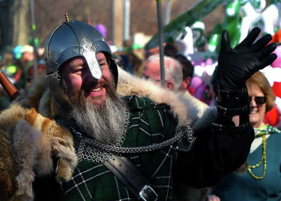 A participant with the Irish Heritage Society of Milford takes part in the 29th annual St. Patrick's Day parade along Broad Street in downtown Milford, Conn. on Saturday Mar. 8, 2019. Photo: Christian Abraham / Hearst Connecticut Media / Connecticut Post