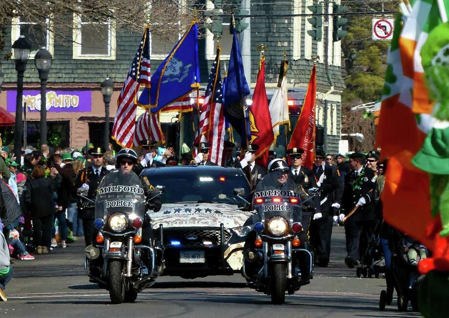 The Milford Police Department leads the 29th annual St. Patrick's Day parade along Broad Street on Saturday. Photo: Christian Abraham / Hearst Connecticut Media / Connecticut Post