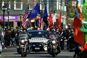 The Milford Police Department leads the 29th annual St. Patrick's Day parade along Broad Street on Saturday.