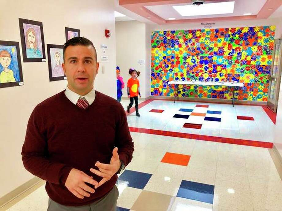 New Berlin Schools Superintendent Adam Ehrman discusses the benefits of the school district's $14.5 million elementary school built in 2009 in this Friday, March 1, 2019 photo. The district built the school with the promise of a $5 million state contribution from the 20-year-old school construction grant program. But the program hasn't been funded for a decade and New Berlin's wait for the state subsidy hampers the district's effort to fix the problems of a crowded, outdated junior-senior high school. As new Illinois Gov. J.B. Pritzker pushes for approval of a multibillion, statewide capital construction program, public school officials press for funding the grant program, which has a 15-year waiting list of 285 projects seeking state-subsidy approval. Photo: AP Photo/John O'Connor