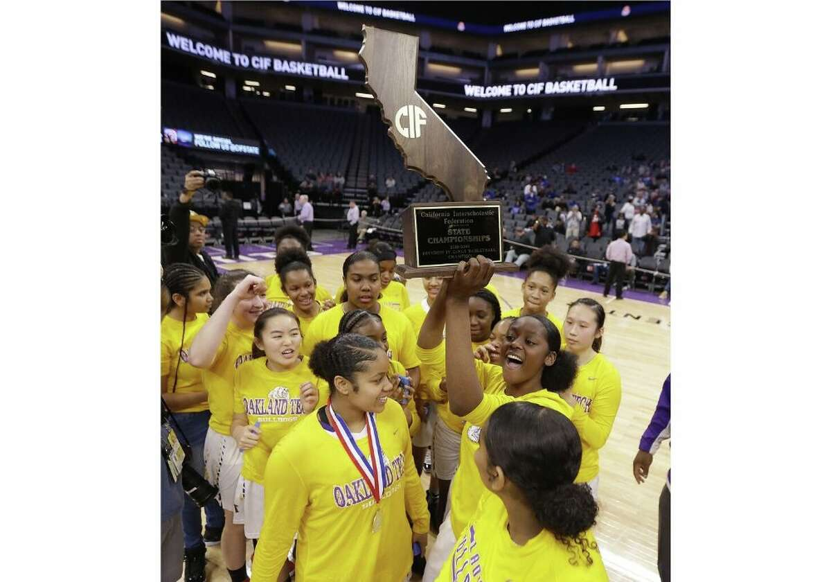 Oakland Tech players celebrate after beating Northview High School 55-37 in the CIF girls' Division IV state high school basketball championship game, Saturday, March 9, 2019, in Sacramento, Calif.(AP Photo/Rich Pedroncelli)
