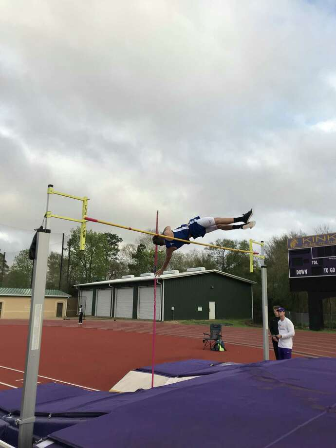Pasadena-First Baptist Christian Academy pole vaulter Micah Swadley attempts to clear 9-6 on his second attempt. But his head came in contact with the bar, bringing the bar down. Photo: Robert Avery