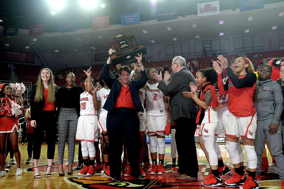 Lamar's head coach Robin Harmony lifts up their Southland conference trophy after beating McNeese State during their regional final match-up Saturday at the Montagne Center. Photo taken Saturday, March 9, 2019 Kim Brent/The Enterprise Photo: Kim Brent, The Enterprise / BEN
