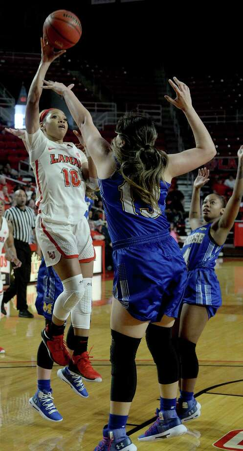 Lamar's Chastadie Barrs puts up a jumper over McNeese State's Cinthya Rivas during their regional final match-up Saturday at the Montagne Center. Photo taken Saturday, March 9, 2019 Kim Brent/The Enterprise Photo: Kim Brent, The Enterprise / BEN
