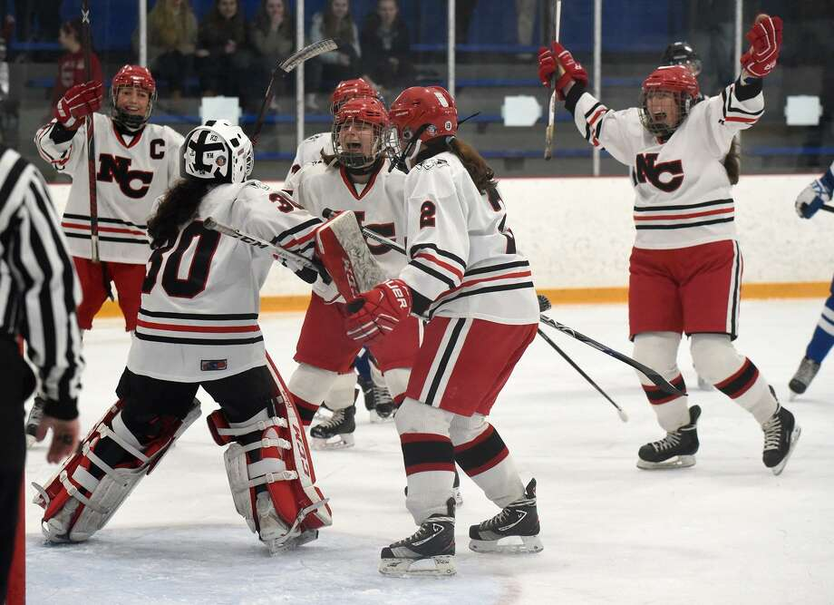 The New Canaan Rams begin their celebration after winning the CHSGHA state championship with a 3-1 victory over Darien in the final at Bennett Rink in West Haven on Saturday. Photo: Dave Stewart / For Hearst Connecticut Media / Hearst Connecticut Media