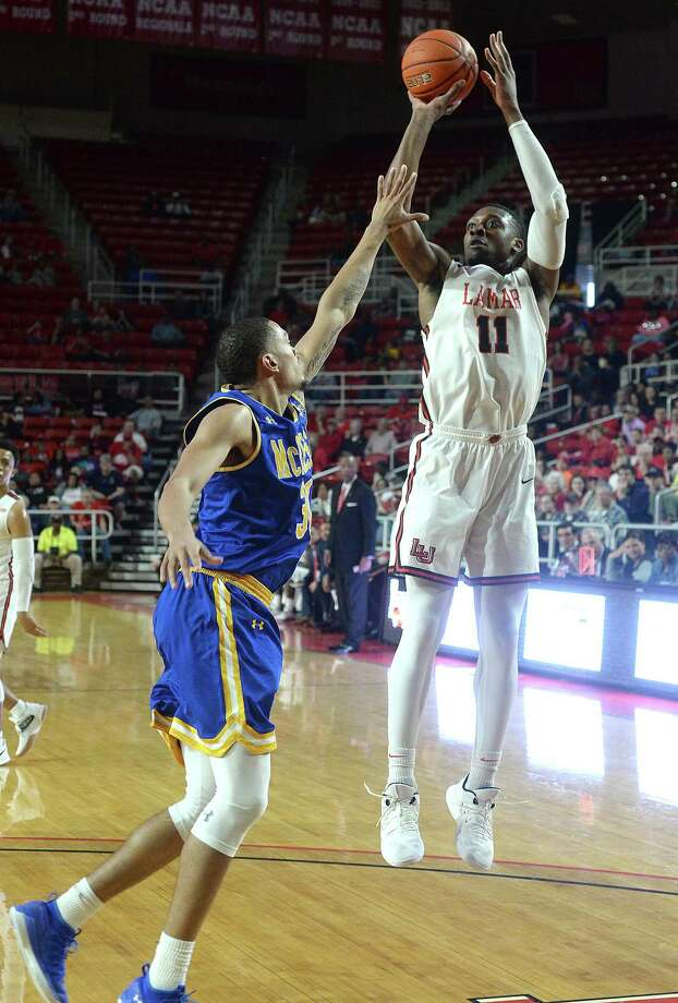 Lamar's Josh Nzeakor shoots over McNeese State's Adrian Brown during their regional final match-up Saturday at the Montagne Center. Photo taken Saturday, March 9, 2019 Kim Brent/The Enterprise Photo: Kim Brent, The Enterprise / BEN