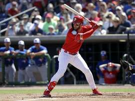 Philadelphia Phillies' Bryce Harper bats against the Toronto Blue Jays during the first inning of a spring training baseball game Saturday, March 9, 2019, in Clearwater, Fla. (AP Photo/Chris O'Meara)