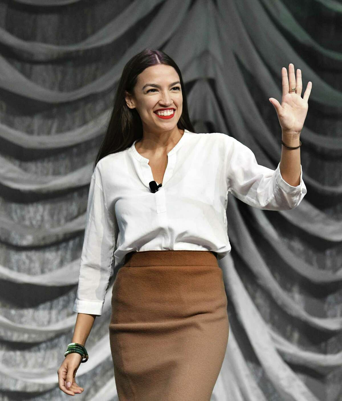 New York U.S. Rep. Alexandria Ocasio-Cortez enters the stage for her conversation with Briahna Joy Gray about about identity, race and class at the Austin Convention Center during the SXSW Conference & Festivals on Saturday, March 9, 2019.