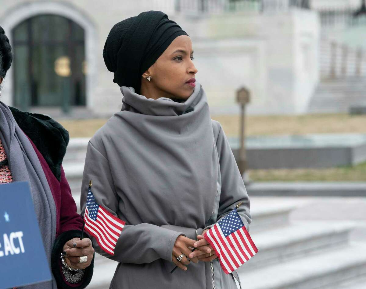 """Rep. Ilhan Omar, D-Minn., stands with fellow Democrats as they rally outside the Capitol ahead of passage of H.R. 1, """"The For the People Act,"""" a bill which aims to expand voting rights and strengthen ethics rules, in Washington, Friday, March 8, 2019. The House passed a resolution to condemn anti-Semitism and other bigotry on Thursday following debate over Omar's recent comments suggesting House supporters of Israel have dual allegiances. (AP Photo/J. Scott Applewhite)"""