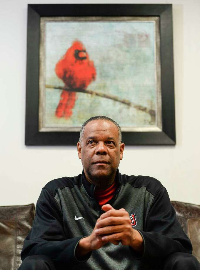 Lamar University men's basketball head coach Tic Price poses for a photo in his office at Lamar on Monday. Photo taken on Monday, 03/04/19. Ryan Welch/The Enterprise Photo: Ryan Welch, The Enterprise / ©Ryan Welch