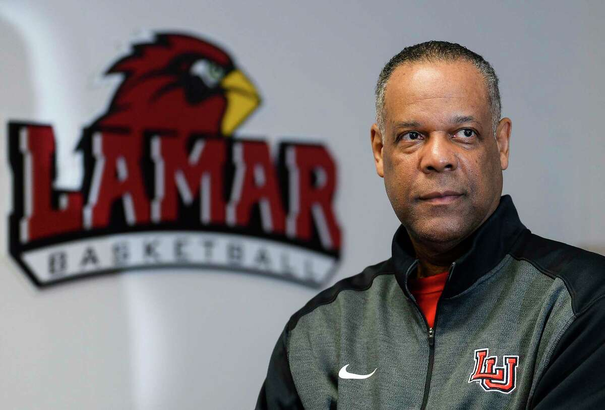 Lamar University men's basketball head coach Tic Price poses for a photo in his office at Lamar. Photo taken on Monday, 03/04/19. Ryan Welch/The Enterprise
