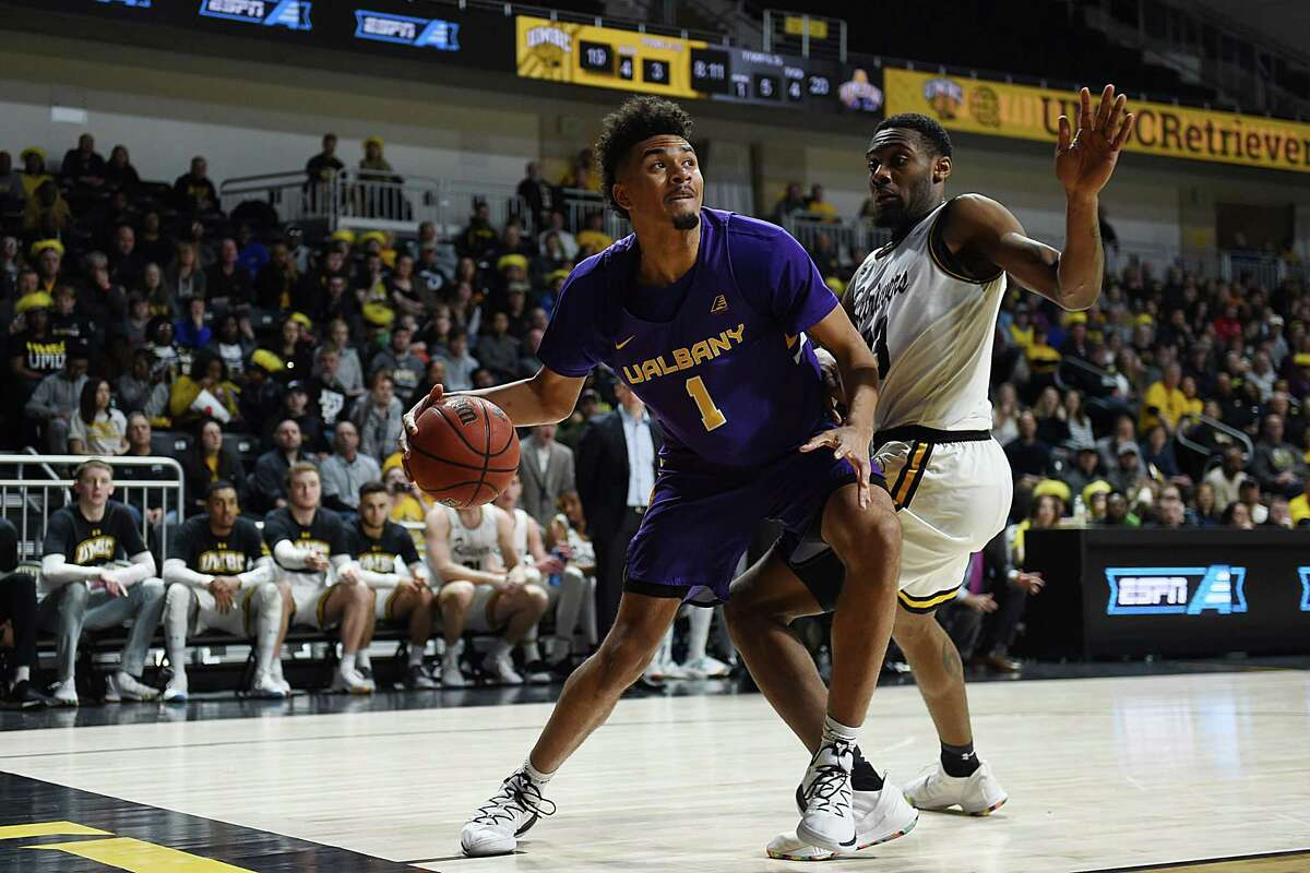Malachi de Sousa drives to the basket against UMBC during the Danes' America East Tournament quarterfinal loss on Saturday, March 9, 2019. (Gail Burton / Courtesy of UMBC)