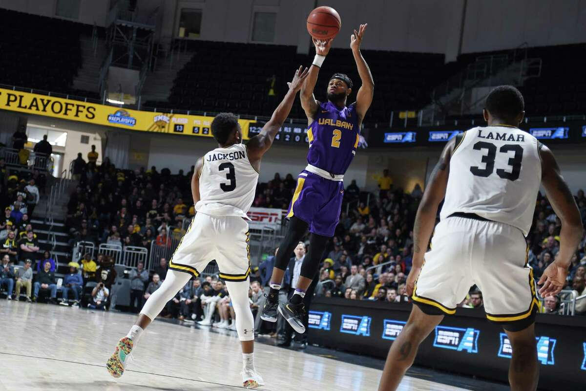 Ahmad Clark of UAlbany puts up a shot against UMBC during the Danes' America East Tournament quarterfinal loss on Saturday, March 9, 2019. Clark had 12 points, all in the second half. (Gail Burton / Courtesy of UMBC)