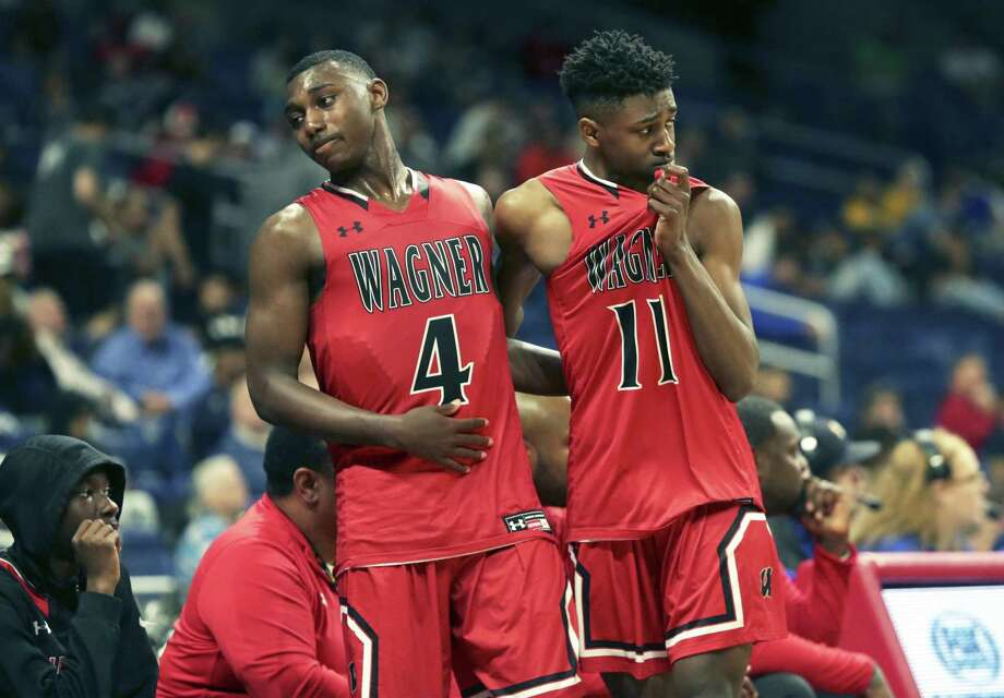 Wagner guards Jalen, left, and Ja'Sean Jackson console each other after both brothers fouled out Saturday night. Photo: Tom Reel /Staff Photographer / 2019 SAN ANTONIO EXPRESS-NEWS
