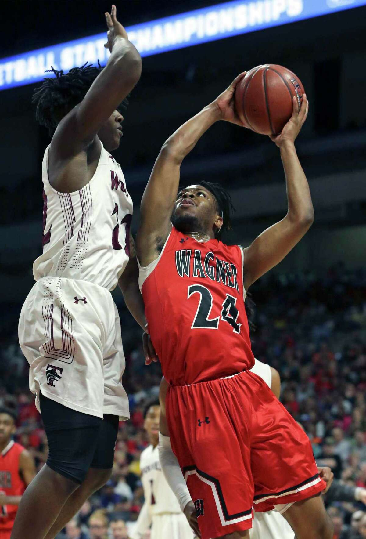 Journee Phillips takes the ball up on Dwaylen Russell as Wagner plays Mansfield Timberview in the Class 5A boys state final basketball game at the Alamodome on March 9, 2019.