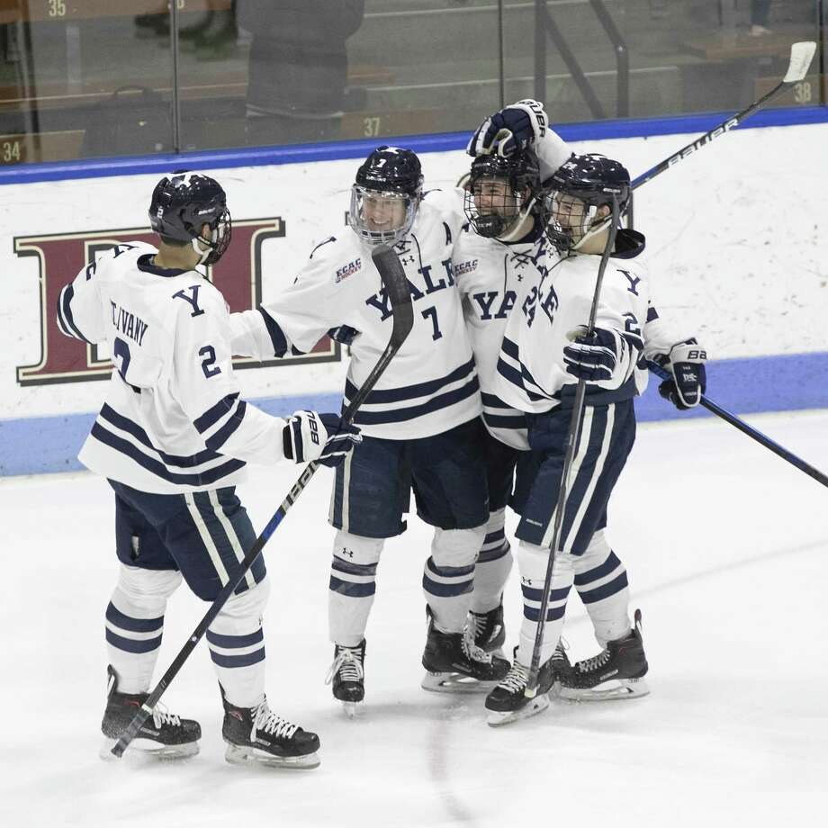 Joe Snively (7) celebrates his second-period goal with teammates on Saturday at Ingalls Rink. Photo: Steve Musco / Yale Athletics / ©2018 - 2019 Steve Musco , All rights reserved