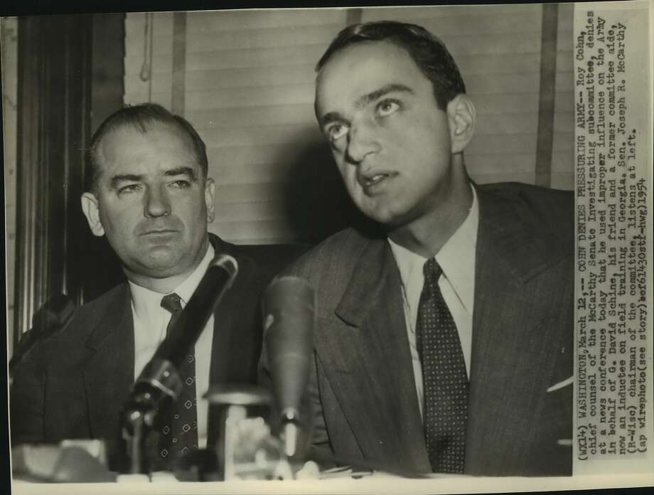 Roy Cohn, chief counsel of the McCarthy Senate Investigating subcommittee, denies at a news conference today that he used improper influence on the Army in behalf of G. David Schine, his friend and a former committee aide, now an inductee on field training in Georgia.  Senator Joseph R. McCarthy, Republic, Wise, chairman of the committee, listens at left. Photo: AP (Associated Press)