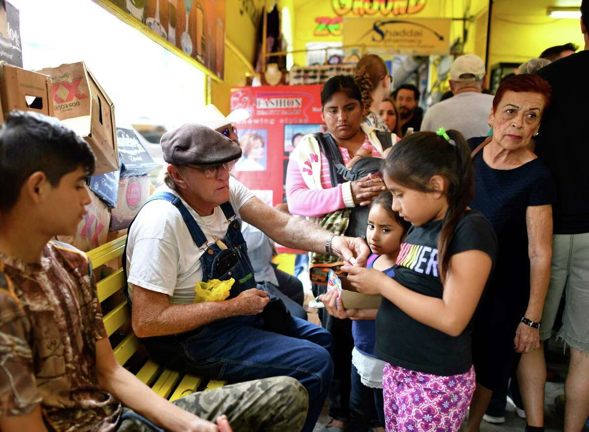 Gene Holley, who is from Carbondale, Ill., buys candy from children in Nuevo Progreso, Mexico, on Saturday, Feb. 23, 2019. Years of drug cartel violence has all but killed jaunts across the Rio Grande to Mexican border cities like Matamoros and Reynosa, but Nuevo Progreso has somehow remained an oasis. It is as vibrant and busy as ever, with shop owners expanding square footage, street vendors doing a brisk trade, and long lines of beauticians offering bargain manicures and pedicures. Winter Texans make up a large part of the clientele, in part because they can cheaply fill prescriptions, take care of dental work, and imbibe generously of mixed margaritas.