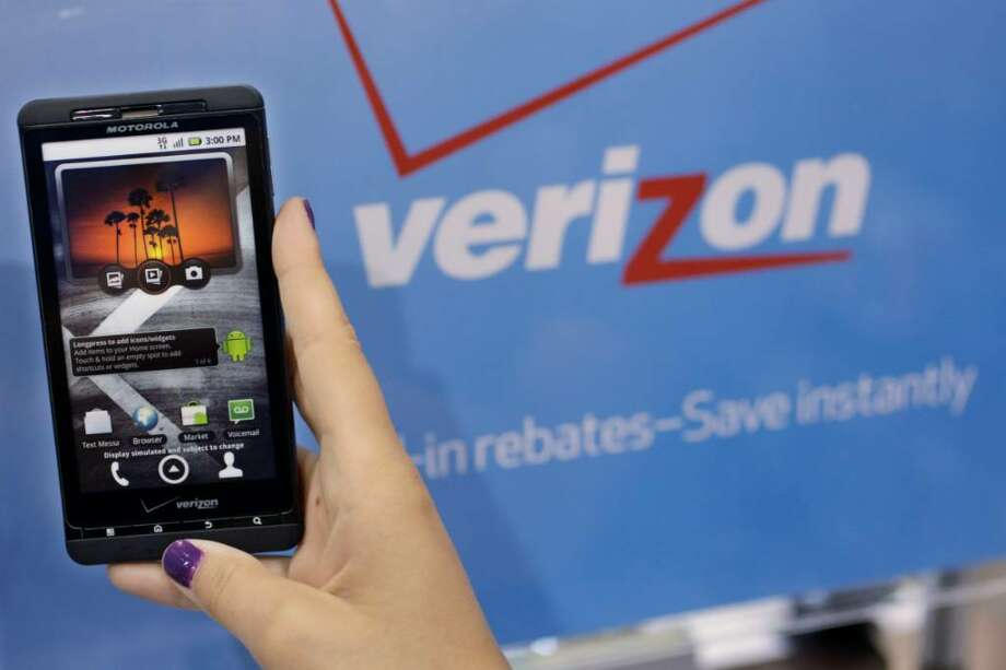 Verizon profits from its participation in Verizon Wireless, but it is shedding 11,000 jobs in its land-line service, putting the company in the red for the quarter. Photo: Paul Sakuma