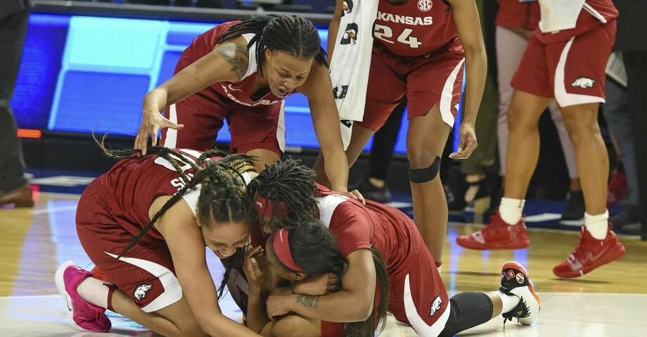Arkansas players celebrate after defeating Texas A&M in an NCAA college basketball game in the Southeastern Conference women's tournament Saturday, March 9, 2019, in Greenville, S.C. (AP Photo/Richard Shiro) Photo: Richard Shiro/Associated Press