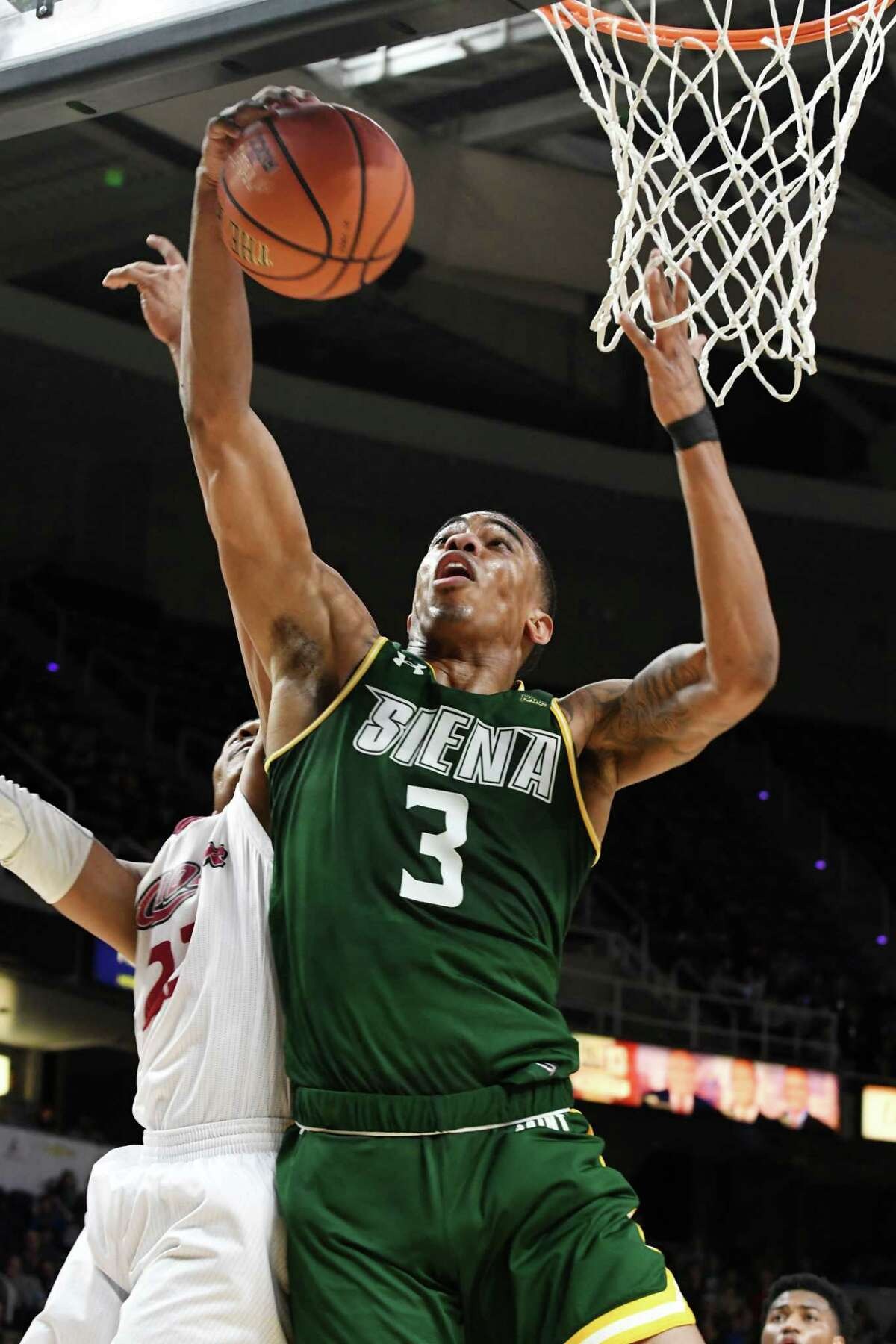Siena forward Manny Camper pulls down a rebound during a MAAC Tournament quarterfinal game against Rider University on Saturday night, March 9, 2019, at the Times Union Center in Albany, N.Y. (Will Waldron/Times Union)