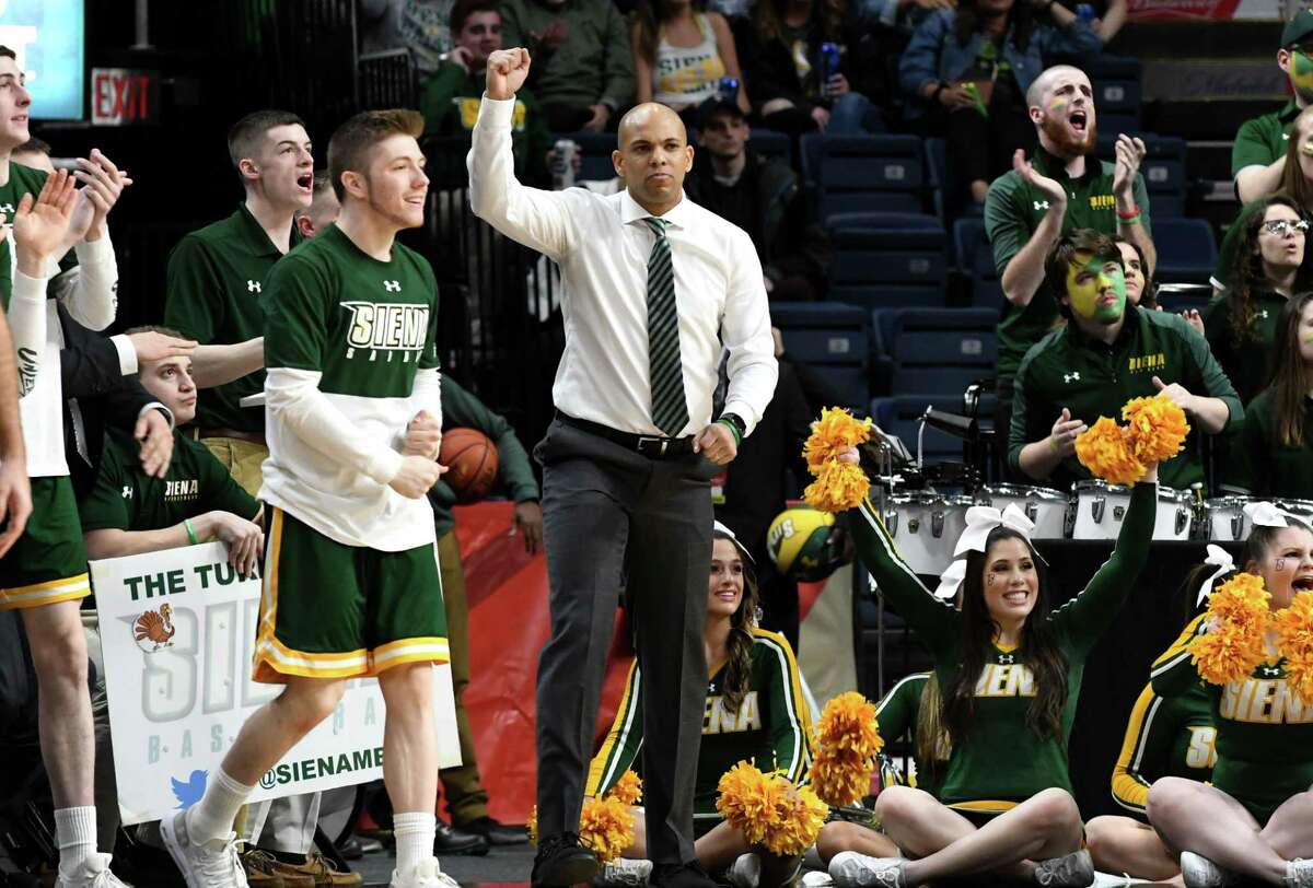 Siena coach Jamion Christian cheers for his team at the end of the first half against Rider during a MAAC Tournament quarterfinal game on Saturday night, March 9, 2019, at the Times Union Center in Albany, N.Y. (Will Waldron/Times Union)