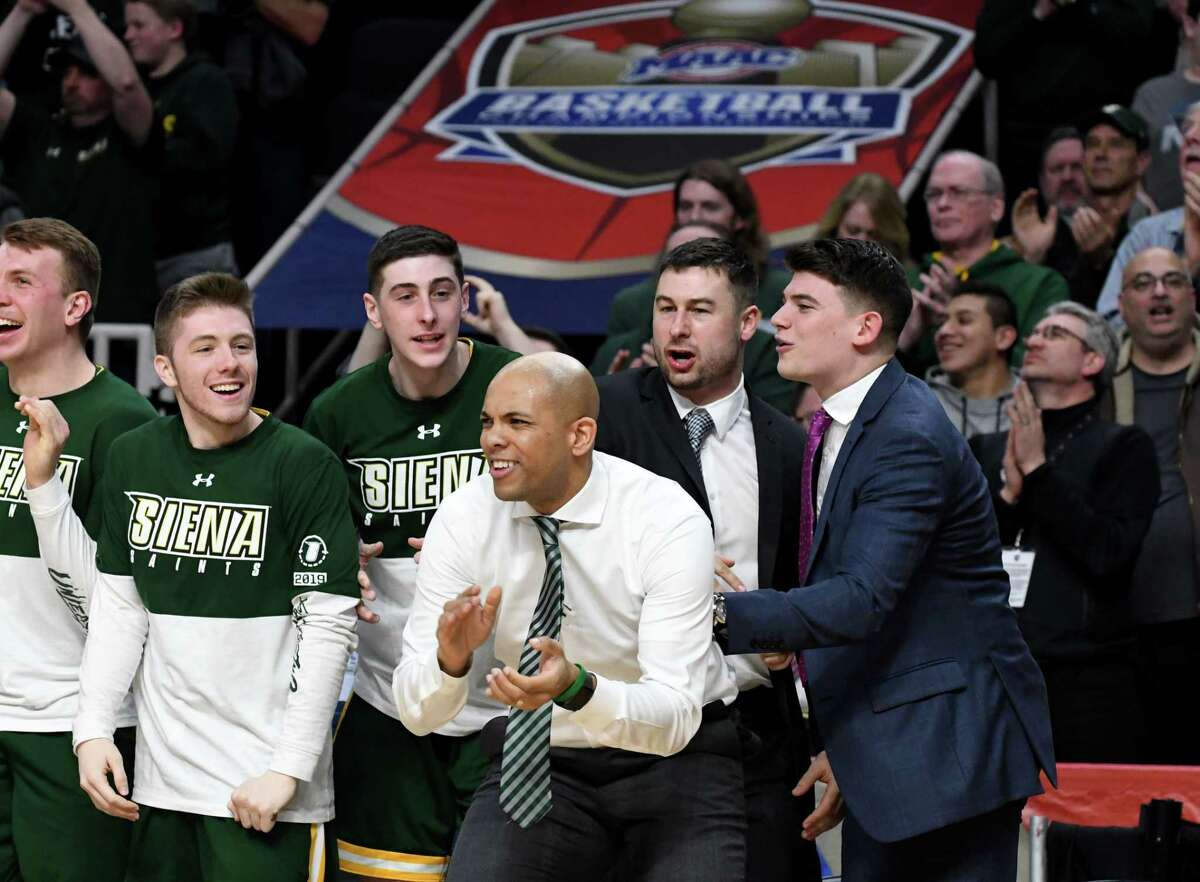 Siena coach Jamion Christian celebrates after beating Rider University 87-81 during a MAAC Tournament quarterfinal game on Saturday night, March 9, 2019, at the Times Union Center in Albany, N.Y. (Will Waldron/Times Union)