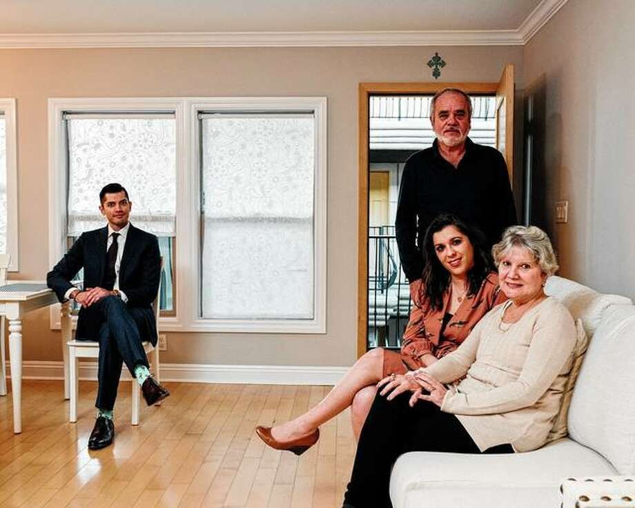 Susan Alvarez sits in her new apartment in San Diego with her mother, Sonia Alvarez; father, Manuel Alvarez; and real estate broker Fredy Garcia. Many 30-somethings still are supported by their parents as a result of difficult economic headwinds. Photo: John Francis Peters | The New York Times