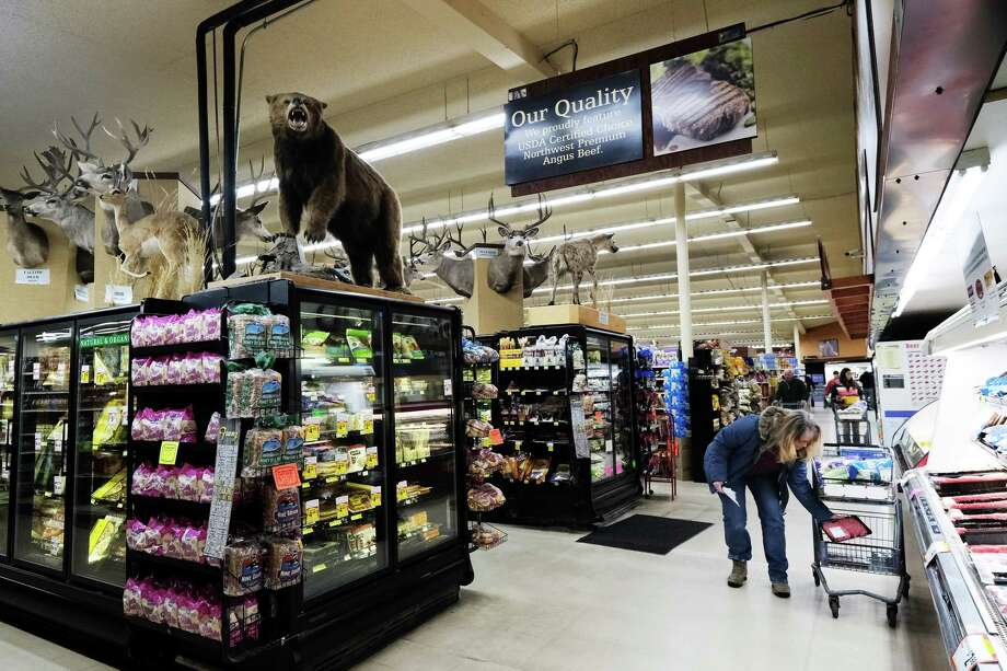Dozens of taxidermied big game animals look down on shoppers at Hank's Harvest grocery store in Twisp, March 3, 2019. The animals were all killed by store owner Hank Konrad, many on trips to Africa or Canada. The animals, which include two lions, are prominently displayed in the store. Photo: Genna Martin / seattlepi.com