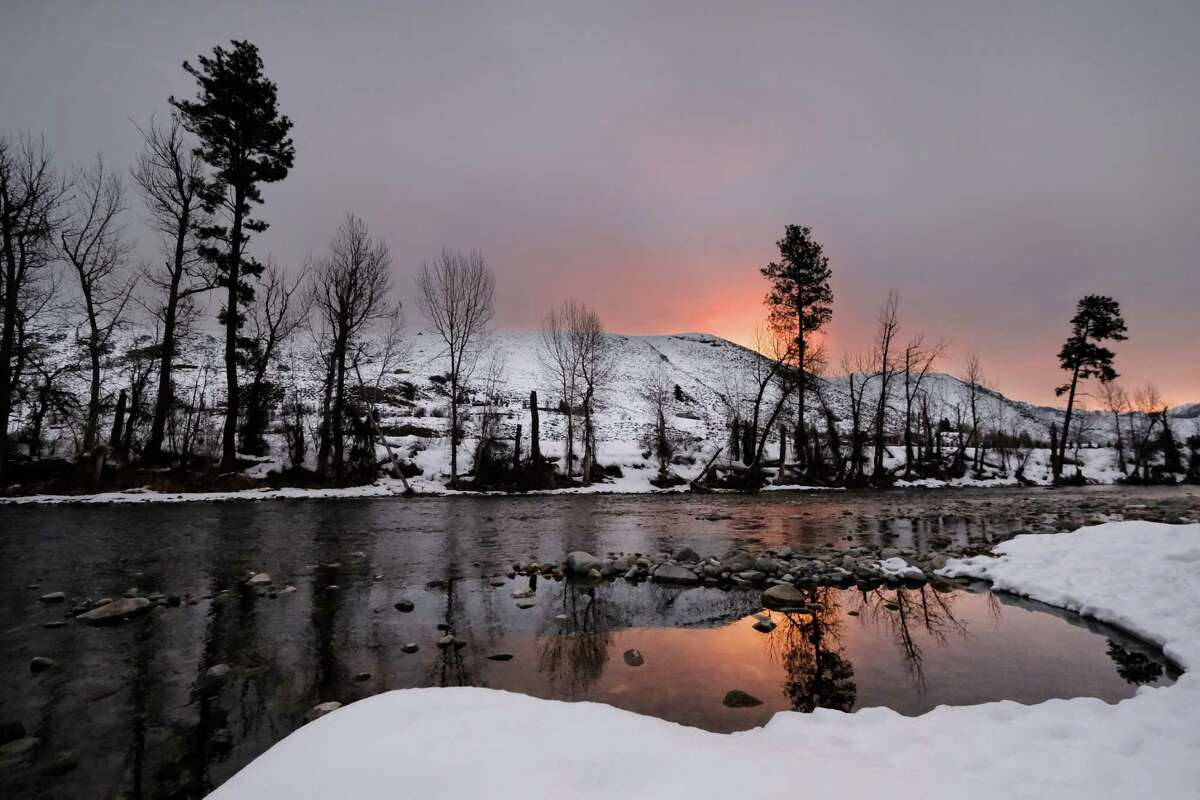 Sunrise colors the sky above the Methow River near Winthrop, March 3, 2019.