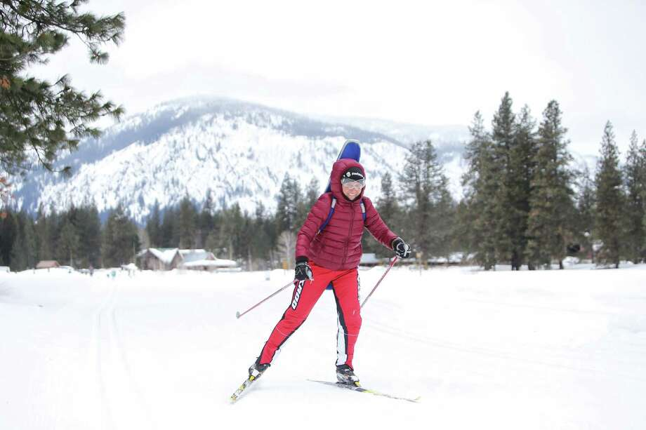 A cross-country skier passes by on one of the 120 miles of groomed ski trails in Mazama maintained by the Methow Valley SportsTrails Association, March 3, 2019. Methow features one of the largest trail networks in North America. Photo: Genna Martin / seattlepi.com
