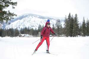 A cross-country skier passes by on one of the 120 miles of groomed ski trails in Mazama maintained by the Methow Valley SportsTrails Association, March 3, 2019. Methow features one of the largest trail networks in North America.