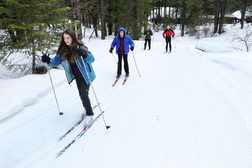 A Bush School cross-country ski class skis down the groomed trails in Mazama, March 3, 2019.