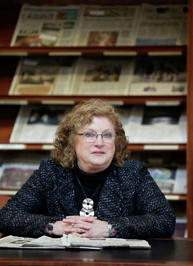"""Penelope Muse Abernathy, a University of North Carolina professor, stands with the daily newspaper selection in the Park Library at the School of Journalism in Chapel Hill. """"Strong newspapers have been good for democracy, and both educators and informers of a citizenry and its governing officials. They have been problem-solvers,"""" said Abernathy, who studies news industry trends and oversaw the """"news desert"""" report released the previous fall. Photo: Gerry Broome 