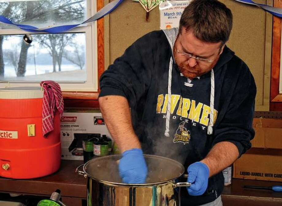 Clifton Hungerford prepares a pot of jambalaya Saturday during the Hobby Horse Polar Bear Plunge and Jambalaya cook-off. Photo: Samantha McDaniel-Ogletree | Journal-Courier