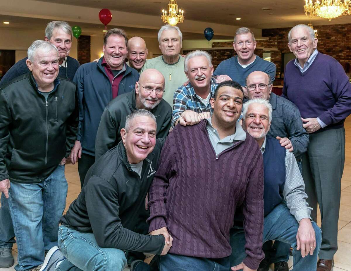 A 21st birthday party was held at Elks Lodge 771 in Middletown for Tony Petrezzello Feb. 24, with over 150 people in attendance to celebrate the occasion. Petrezzello, in purple, shares a moment with friends from the Northern Middlesex YMCA and Middlesex County Chamber of Commerce President Larry McHugh, right.