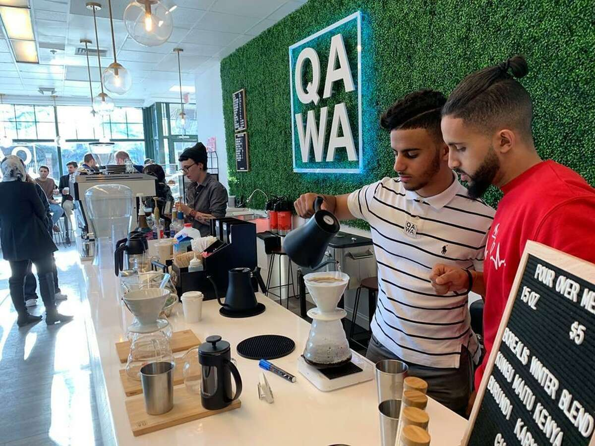 Qawa Coffee owners Abulrahman Alhadheri, in red, and his wife Amirah Ailaqi (not shown) have transformed the former Disco Chick location in Metro Square on Main Street in Middletown into a coffee house.