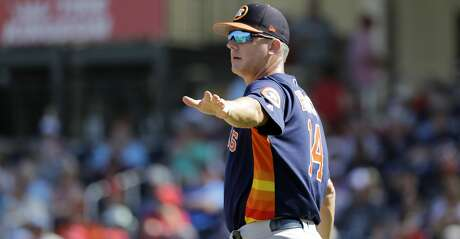 Houston Astros manager AJ Hinch motions to the bullpen as he walks out to the mound to make pitching change during the third inning of an exhibition spring training baseball game against the Washington Nationals Sunday, March 3, 2019, in West Palm Beach, Fla. (AP Photo/Jeff Roberson)