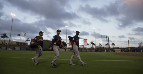 Houston Astros players roll in for the spring training opening game against Washington Nationals at Fitteam Ballpark of The Palm Beaches on Saturday, Feb. 23, 2019, in West Palm Beach.