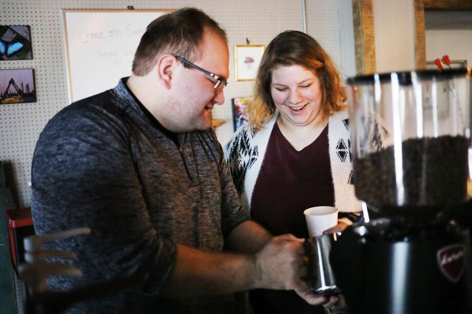 Brett Nowak, left, and Maegan Ross, right, prepare coffee drinks at their mobile coffee stand, Pioneer Coffee Catering, inside The Tax Cafe on Thursday, March 7, 2019 in Midland. (Katy Kildee/kkildee@mdn.net) Photo: (Katy Kildee/kkildee@mdn.net)