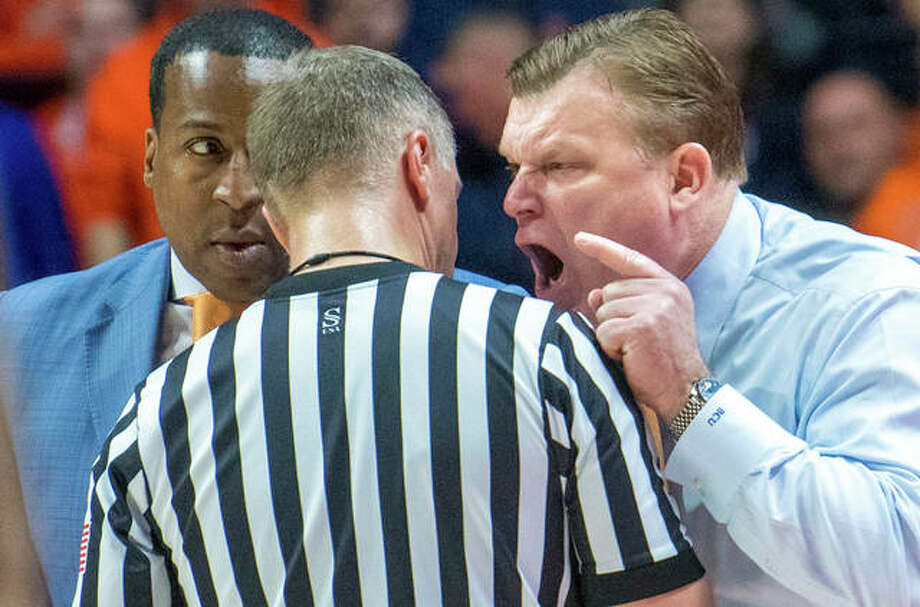 Illinois coach Brad Underwood (right) makes point to a referee as assistant Ron Coleman (left) listens during a Feb. 24 game against Penn State in Champaign. The teams met again Sunday in State College, Penn. Photo: Associated Press