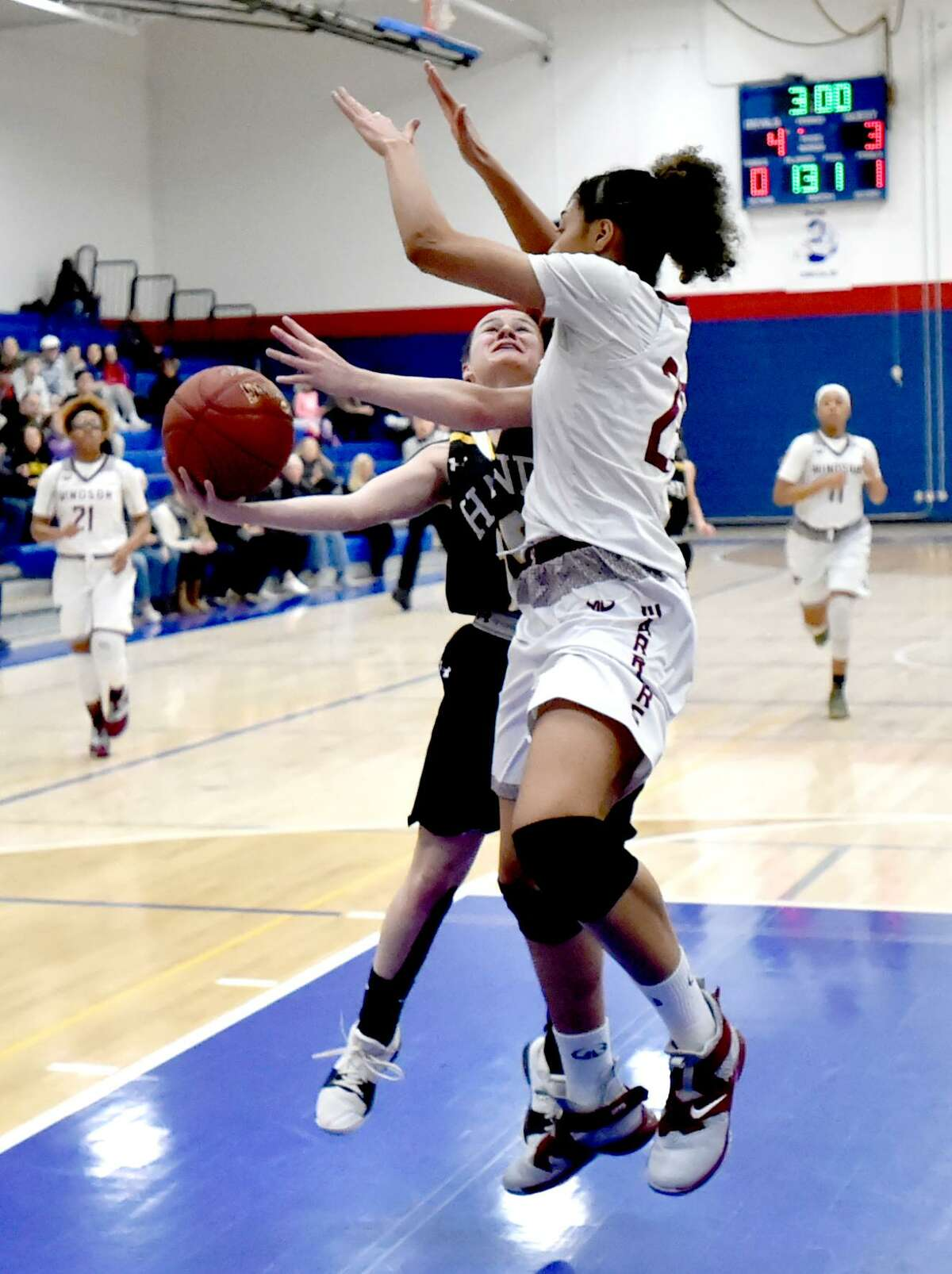 Plainville, Connecticut - Friday, March 58 2019: Windsor H.S. vs. Daniel Hand H.S. girls basketball during the semi-finals of the CIAC 2019 State Girls Basketball Tournament Friday evening at Plainville High School.
