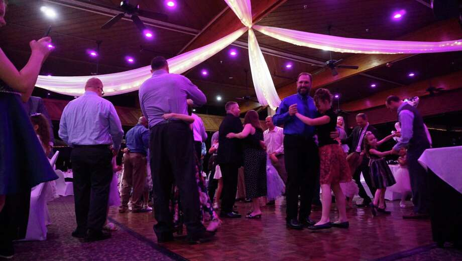 "Fathers and their daughters gently swing to Tim McGraw's ""My Little Girl"" as the opening dance at the Daddy Daughter Dance on March 8, 2019 in Atascocita, TX. Photo: Nguyen Le / Staff Photo"