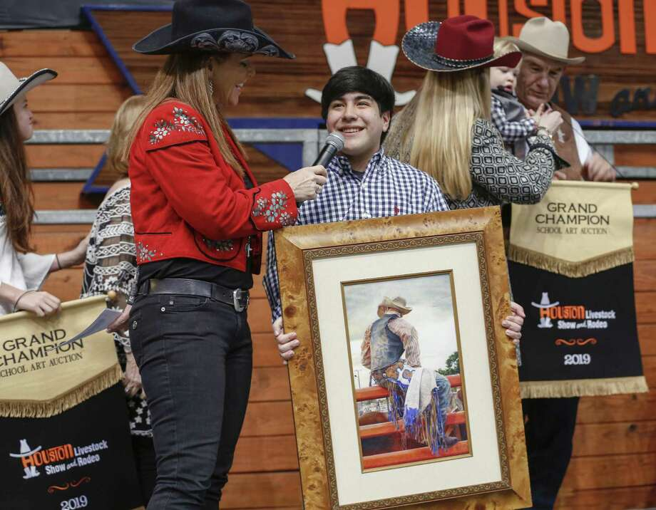 "Patti Smith interviews Hector Maldonado, 18, after his colored drawing, ""After the Storm Comes a Calm"" sold for $240,000 (Rodeo record) during the annual School Art Auction at NRG arena sales Pavillion Sunday, March 10, 2019, in Houston. ( Steve Gonzales / Houston Chronicle ) Photo: Steve Gonzales,  Houston Chronicle / Houston Chronicle / © 2019 Houston Chronicle"
