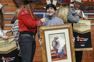"Patti Smith interviews Hector Maldonado, 18, after his colored drawing, ""After the Storm Comes a Calm"" sold for $240,000 (Rodeo record) during the annual School Art Auction at NRG arena sales Pavillion Sunday, March 10, 2019, in Houston. ( Steve Gonzales / Houston Chronicle )"