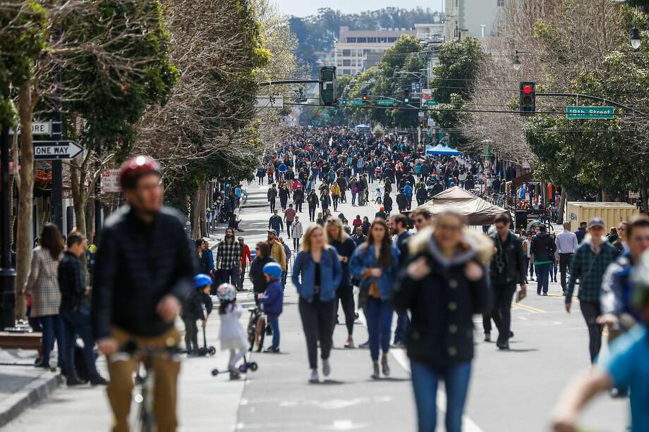 Crowds stroll up and down Valencia Street, which was closed to cars to allow people to explore the area during the first Sunday Streets of the year. Photo: Gabrielle Lurie / The Chronicle
