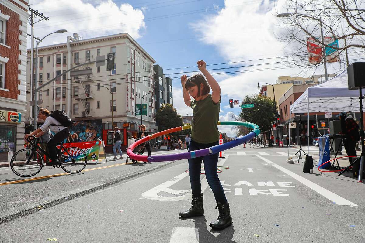 Delaney Rosenbloom, 8, (center) of Reno, Nevada hoola hooped during Sunday Streets where Valencia Street was car-free and open for the public to enjoy in San Francisco, California, on Sunday, March 10, 2019.