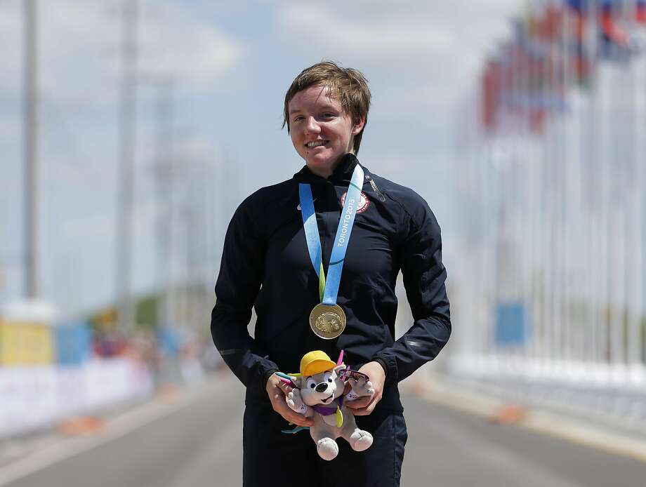 FILE - In this Wednesday, July 22, 2015 file photo, United States gold medalist Kelly Catlin poses after winning  the women's individual time trial cycling competition at the Pan Am Games in Milton, Ontario. Olympic track cyclist Kelly Catlin, who helped the U.S. women's pursuit team win the silver medal at the Rio de Janeiro Games in 2016, died Friday, March 8, 2019 at her home in California. She was 23. (AP Photo/Felipe Dana, File) Photo: Felipe Dana, Associated Press