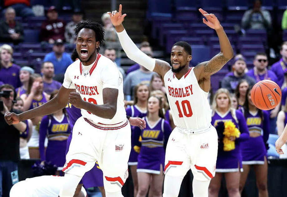 Bradley's Koch Bar and Elijah Childs (10) celebrate as the final horn sounds Sunday during the championship game against Northern Iowa in the Missouri Valley Conference Tournament in St. Louis. Photo: Associated Press